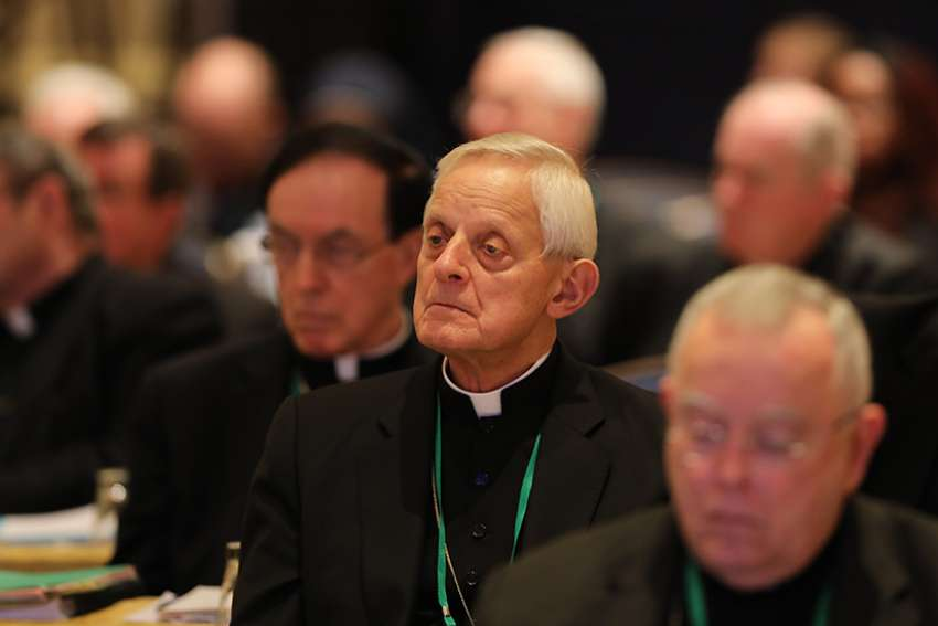 Cardinal Donald W. Wuerl, apostolic administrator of the Washington Archdiocese, listens to a speaker Nov. 14 at the fall general assembly of the U.S. Conference of Catholic Bishops in Baltimore.