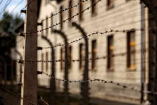 Lines of barbed-wire fencing enclose the Auschwitz-Birkenau Nazi death camp in Oswiecim, Poland, in this Sept. 4, 2015, file photo.