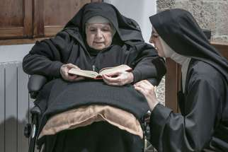 Sister Maria Giuseppina (left) and Sister Maria Caterina (right) are among 10 remaining nuns in a convent on the island of Sardinia who are breaking their silence and embracing the internet in an effort to ensure their order's survival. This photo is from an exhibition being held at the Santa Chiara convent in Sardinia.