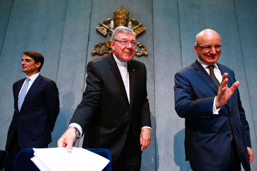 Jean-Baptise de Franssu, left, new president of the Vatican bank, outgoing President Ernst Von Freyberg, right, and Australian Cardinal George Pell, prefect of the Vatican Secretariat for the Economy, leave at the end of a news conference at the Vatican July 9. The Vatican said it will separate its bank's investment business from its church payments work to try to clean up after years of scandal, including allegations of money laundering and tax evasion.