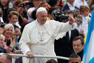 Pope Francis arrives to lead his general audience in St. Peter's Square at the Vatican Sept. 7.