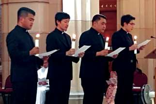 Frater Marlon Bobier Vargas, left, undertook his Profession of Perpetual Vows with the Society of Divine Word (SVD) beside three other young men in their Chicago Chapter in Techny, Ill. on Sept. 21.