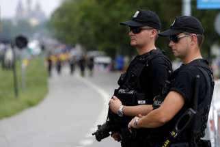 Police officers stand guard during World Youth Day in Krakow, Poland, July 26. Mariusz Ciarka, spokesman for Poland's Warsaw-based police headquarters, said Polish police have raised the official threat level after an Iraqi man was arrested with traces of explosives.