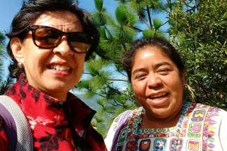 Martha Ines Romero of Pax Christi, left, and Sr. Maudilia Lopez Cardona have been helping Indigenous communities in Latin America deal with the effects of mining operations.