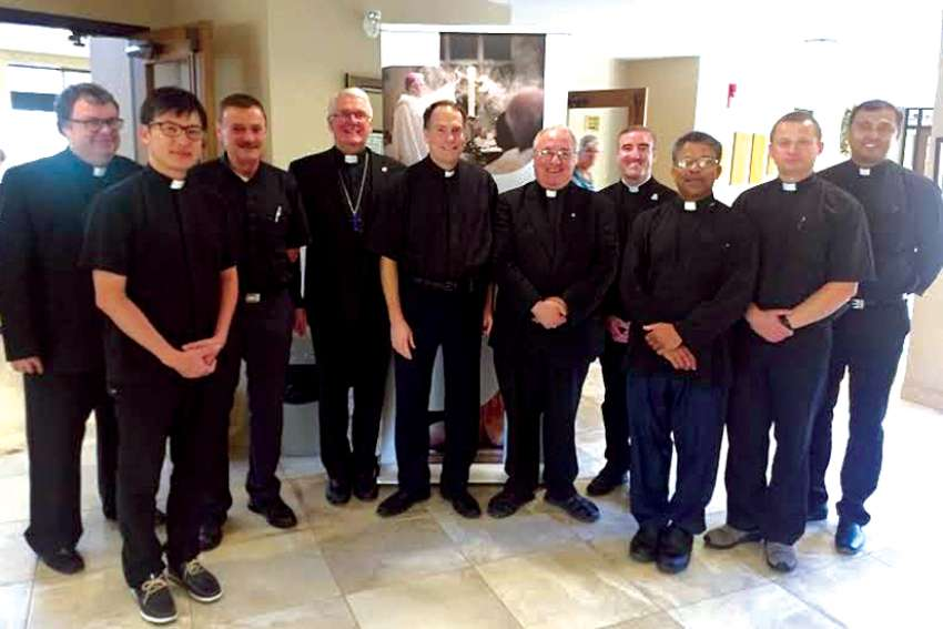 Pastors of parishes in the Kitchener-Waterloo area taking part in the first full wave of the One Heart, One Soul Campaign gathered with Bishop Douglas Crosby at St. Anthony Daniel Parish in Kitchener. From left are: Fr. John Redmond (St. Pius X, Brantford), Fr. Jungheon Kwan (St. Paul Chung, Kitchener), Fr. Stephen Murrin (St. Mark, Kitchener), Bishop Crosby, Fr. Lawrence Parent (Blessed Sacrament, Kitchener), Fr. Malcolm Katzenberger (St. Gregory the Great, Cambridge), Fr. Tim Theriault (St. Anthony Daniel), Fr. Paul Mathew (St. John, Dundalk), Fr. Rafal Tomon (Our Lady of Lourdes, Waterloo), and Fr. Venil D'Souza (associate pastor, St. Aloysius, Kitchener).