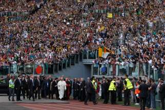 Pope Francis arrives for an encounter with more than 50,000 Catholic charismatics at the Olympic Stadium in Rome June 1. The pope knelt onstage as the crowd prayed over him by singing and speaking in tongues. During the event the pope acknowledged he had once been uncomfortable with the charismatic movement.