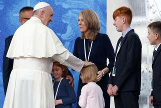 Pope Francis greets family members as he visits the Knock Shrine in Knock, Ireland, Aug. 26.