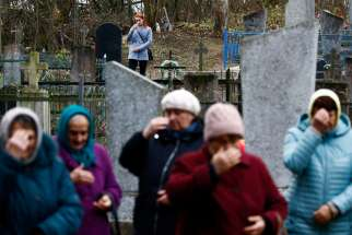 "People in Starayelnya, Belarus, visit graves during All Saints Day Nov. 1, 2019. In a video message to young people participating in the World Youth Encounter in Mexico City, Pope Francis said death teaches people to ""relate with mystery"" and to trust that there is something beyond death."