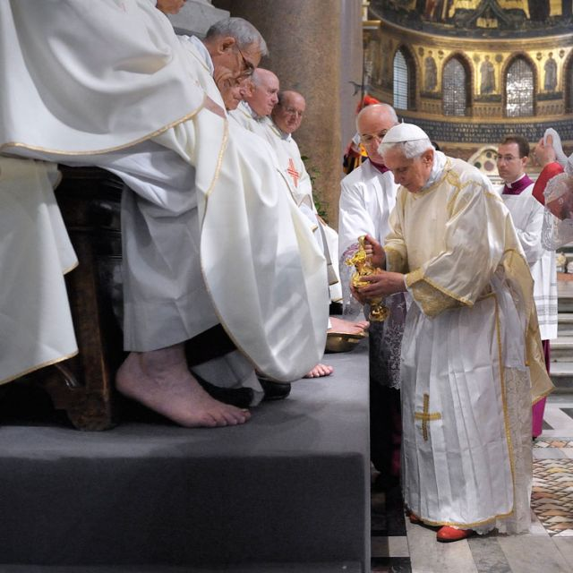 Pope Benedict XVI washes the foot of a priest during the Mass of the Lord's Supper at the Basilica of St. John Lateran in Rome April 5. The foot-washing ritual reflects the call to imitate Christ by serving one another.