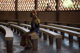 A woman sits in St. Joseph Cathedral in Bambari, Central African Republic, in this 2014 file photo. A Catholic Relief Services official says the situation in the Central African Republic is worsening, as church centers are attacked and more armed groups fight over territory and resources.