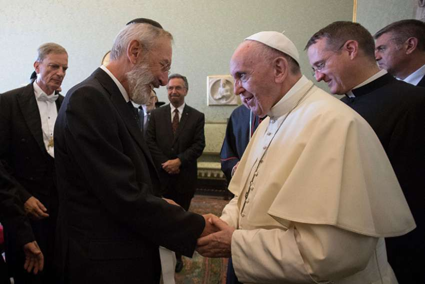 CNS photo/L'Osservatore Romano 08.31.2017 Pope Francis greets Rabbi Riccardo Di Segni, chief rabbi of Rome, during a meeting with representatives of the Conference of European Rabbis, the Rabbinical Council of America and the Commission of the Chief Rabbinate of Israel at the Vatican Aug. 31.