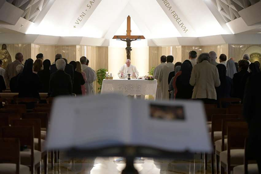 Pope Francis celebrates morning Mass in the chapel of his residence at the Domus Sanctae Marthae at the Vatican Sept. 25.