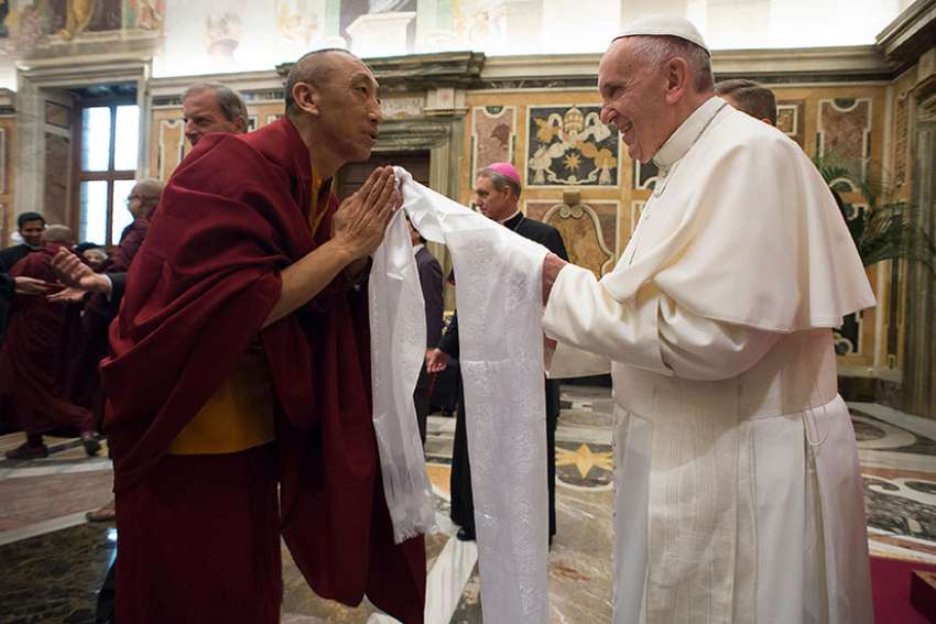 Pope Francis greets a Buddhist monk during a Nov. 3, 2016 audience with religious leaders at the Vatican.