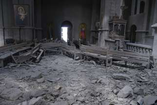 Damaged pews lie amid rubble inside Holy Saviour Cathedral in Shusha, Azerbaijan, after shelling.