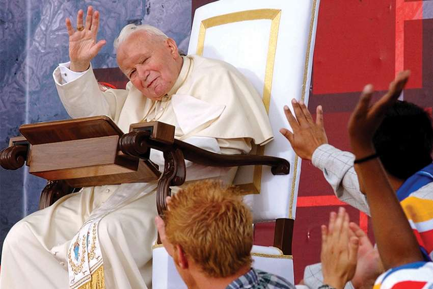In one of Arturo Mari's famous photos, he shows Pope John Paul II celebrating his final international World Youth Day in Toronto in 2002.