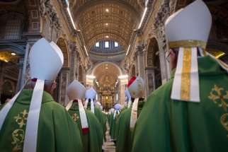 Bishops arrive in procession for the opening Mass of the Synod of Bishops on the family in St. Peter's Basilica at the Vatican Oct. 4.