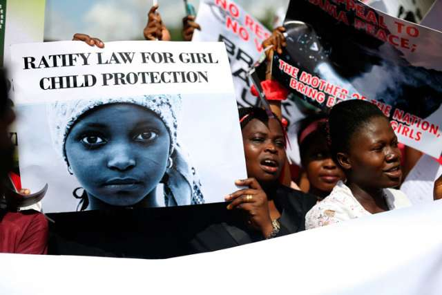 Women holding signs take part in a May 5 protest in Lagos, Nigeria, to demand the release of abducted high school girls. The Islamist militant group Boko Haram claimed responsibility for the abduction of 276 schoolgirls during a raid in the remote villag e of Chibok in April.