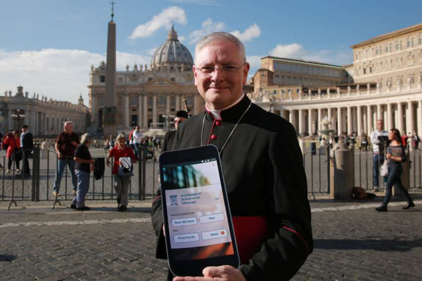 Archbishop Leo Cushley of the Scottish Archdiocese of St. Andrew's and Edinburg launches the new Catholic App in St. Peter's Square on Nov. 22.