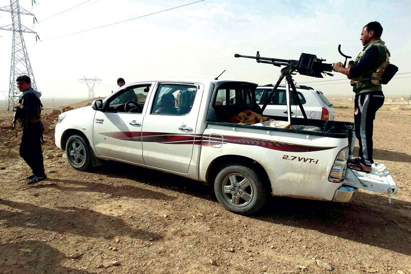 Tribal fighters take part in an intensive security deployment against Islamic State militants in Haditha, Iraq. A Chaldean archbishop has called for U.S. and British troops on the ground to help defeat the Islamic State.