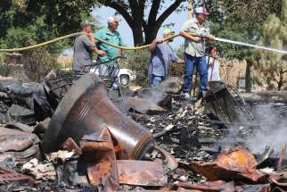 Volunteer firefighters extinguish hot spots July 29, 2019, after fire destroyed the Church of the Visitation in Westphalia, Texas. Since 1883 the parish has served the Catholic community of southwestern Falls County, many of whom are descendents of immigrants from the northwest German region of Westphalia.