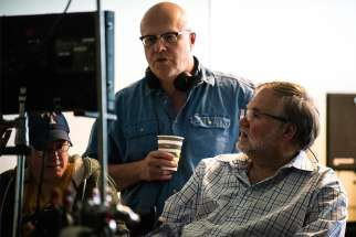 "Co-writers and directors Chuck Konzelman, standing, and Cary Solomon, right, review a scene during the filming of ""Unplanned,"" the story of Abby Johnson, a former Planned Parenthood clinic director, and her decision to join the pro-life movement. The two men said a White House social media summit July 11, 2019, was a needed opportunity for conservatives to discuss how Facebook, Twitter and Google and other outlets are shutting out their voices."