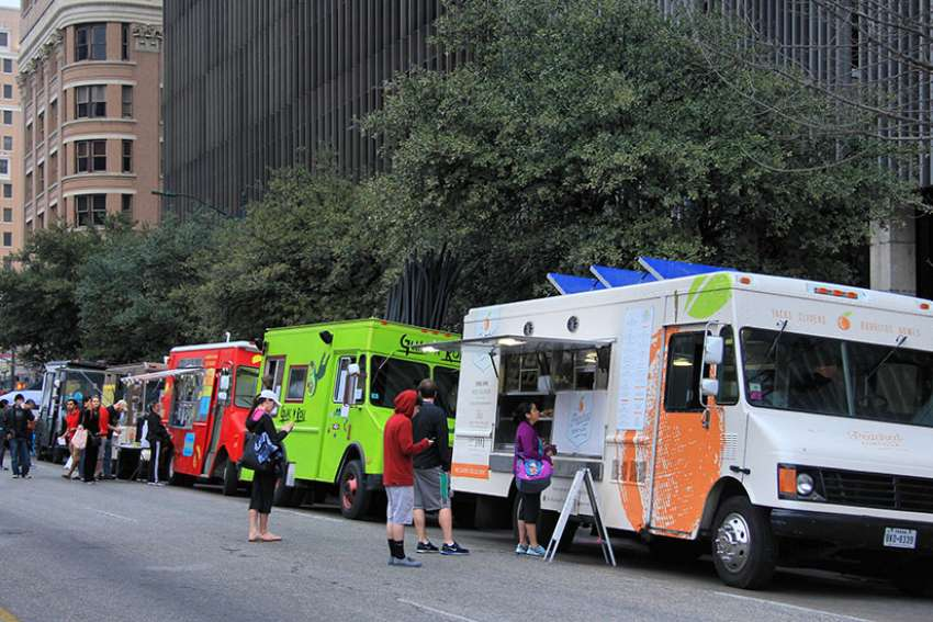 Food trucks seen in Austin, Texas in 2014. Mobile Loaves and Fishes is a Christian non-profit founded by Graham and five other men that delivers about 1,200 meals and essentials from 12 food trucks to homeless people on the streets of Austin every night.