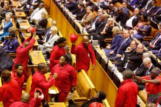 Economic Freedom Fighters disrupt South African President Jacob Zuma during his State of the Nation address in Cape Town Feb. 11.