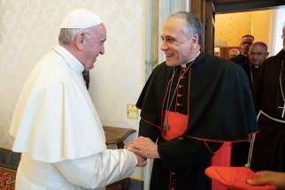 Pope Francis greets Cardinal Daniel N. DiNardo of Galveston-Houston, president of the U.S. Conference of Catholic Bishops, during a meeting with officials of the conference at the Vatican Sept. 13. Also pictured are Cardinal Sean P. O'Malley of Boston, president of the Pontifical Commission for the Protection of Minors, Archbishop Jose H. Gomez of Los Angeles, vice president of the conference, and Msgr. J. Brian Bransfield, general secretary of the conference.