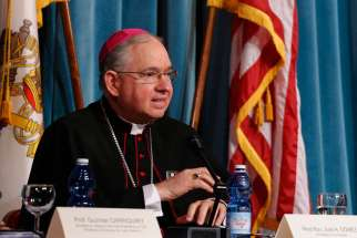 Archbishop Jose H. Gomez of Los Angeles says the California Senate's decision to legalize physician-assisted suicide is a distraction from discussing public health issues like Alzheimer's and Parkinson's. He is pictured at a symposium in Rome May 2.