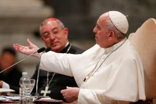 Pope Francis gestures as he addresses more than 1,000 diocesan leaders, both clergy and laity, May 9, 2019, at the Basilica of St. John Lateran, the cathedral of the Diocese of Rome. Seated next to the pope is Cardinal Angelo de Donatis, vicar of Rome.