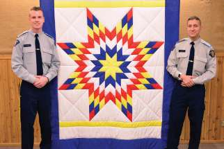 The Kairos Blanket Exercise will now be part of the training for every RCMP cadet, like Matt Plaskett, left, and Habeeb Shah, who recently underwent the exercise at the RCMP Academy in Regina.
