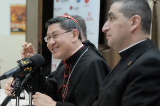 Philippine Cardinal Luis Antonio Tagle of Manila, president of Caritas Internationalis, speaks alongside Maronite Father Paul Karam, president of Caritas Lebanon, during a Jan. 30 visit to Beirut.