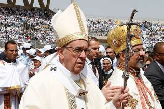 Pope Francis arrives in procession to celebrate Mass at the Air Defence Stadium in Cairo April 29.