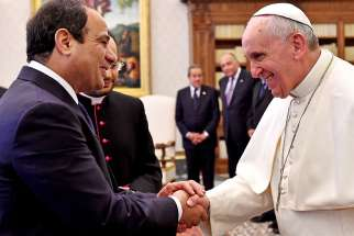Pope Francis and Egypt's President Abdel Fattah al-Sisi shake hands during a private audience in 2014 at the Vatican.