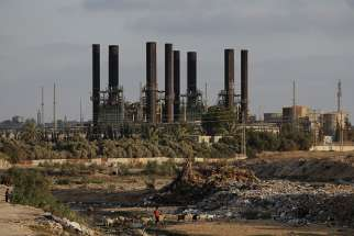 The power plant that generates electricity in the central Gaza Strip is seen June 14. Electrical service is sporadic because of political maneuvering among Palestian groups and the Israeli government, forcing residents to be resourceful in coping in their daily life.
