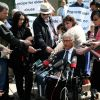 Protestors and media gather following the B.C. Supreme Court decision June 15 to strike down Criminal Code provisions against euthanasia and assisted suicide.