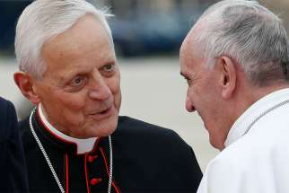 Cardinal Donald W. Wuerl of Washington talks with Pope Francis at Andrews Air Force Base in Maryland near Washington Sept. 22, 2015.