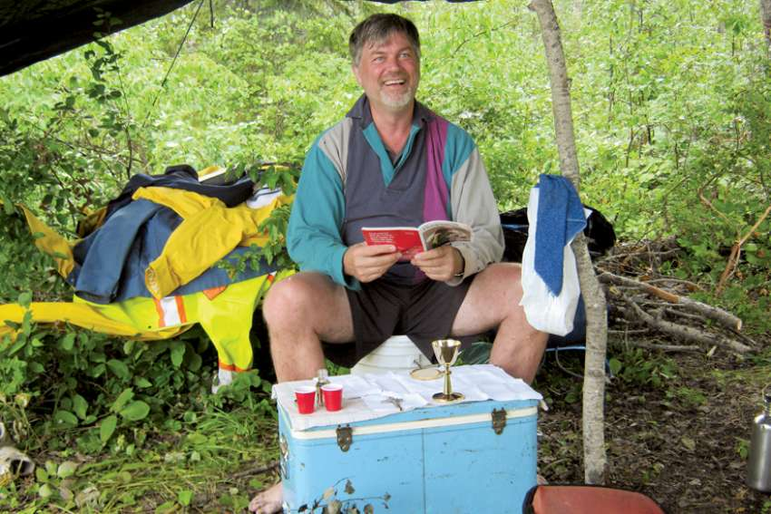 Fr. Jim Kaptein uses a cooler as a makeshift altar in the wild.