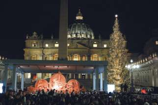 "The Christmas tree and ""Sand Nativity"" are seen after a tree-lighting ceremony in St. Peter's Square at the Vatican Dec. 7."