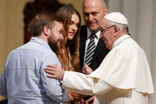 Pope Francis greets a recently married couple as he visits St. Mary's Pro-Cathedral in Dublin Aug. 25.