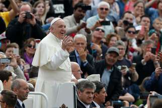 Pope Francis greets the crowd during his general audience in St. Peter's Square at the Vatican May 23.