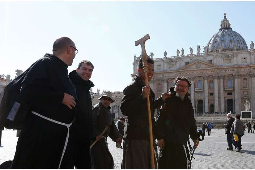 A group of Franciscans representing the four branches of the Franciscan family arrive in St. Peter's Square March 12 after walking from Assisi to Rome.
