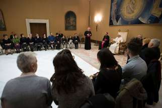 Pope Francis attends a private audience Feb. 22 at the Vatican for Italian family members of those who died in the 2016 Dhaka massacre in Bangladesh.