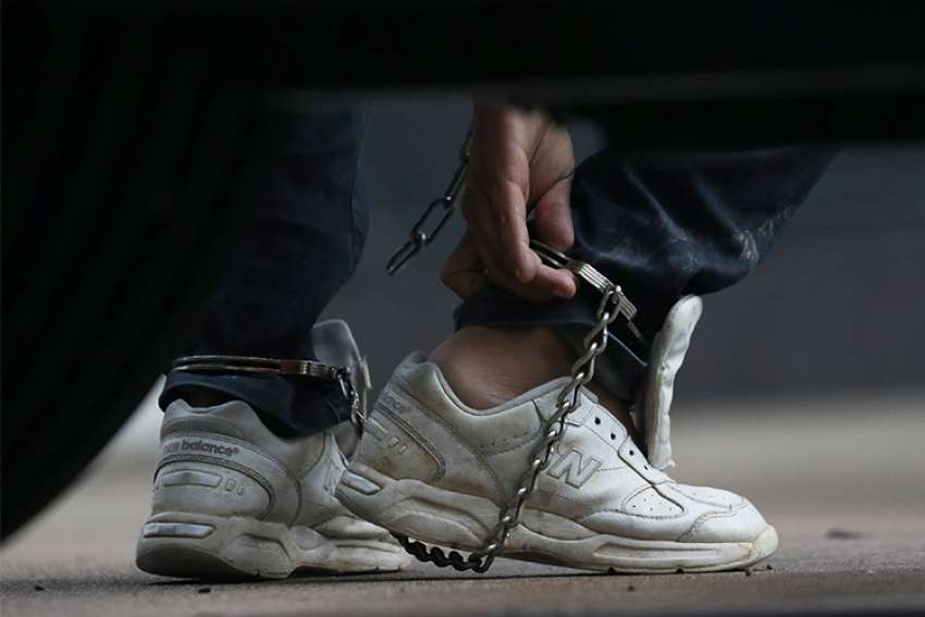 An immigrant entering the U.S. illegally is seen arriving in shackles for a court hearing in McAllen, Texas, June 22.