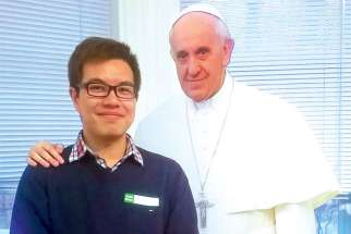 Michael Chen, with a cutout of Pope Francis, at the Jesuit retreat he took part in earlier this year.