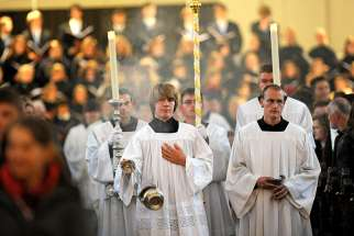 An altar server swings a censer during the opening Mass of the annual meeting of the German bishops' conference in 2010 in Fulda. A 350-page document leaked to German media and published Sept. 12 documents nearly 3,700 cases of alleged sexual abuse of minors by Catholic priests, deacons and clergy in Germany over a 68-year period.