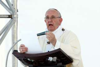 Pope Francis delivers the homily as he celebrates Mass May 27 during his pastoral visit in Genoa, Italy.