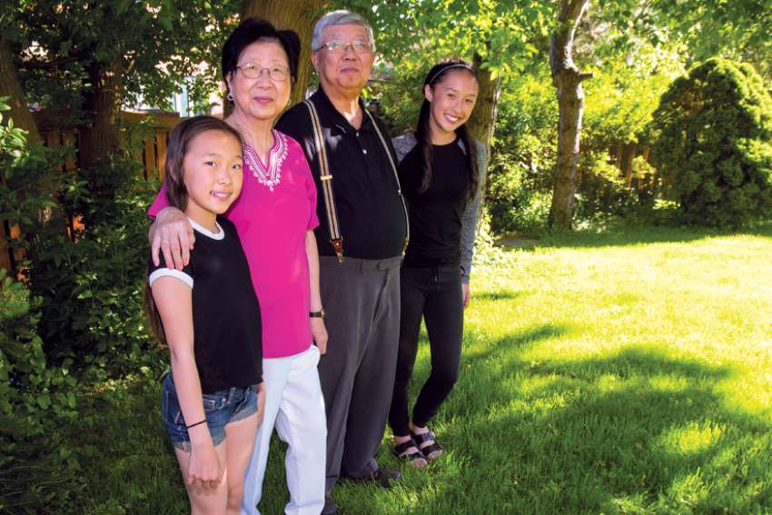 Pauliana and Thomas Kung with their granddaughters Madison and Rachel.