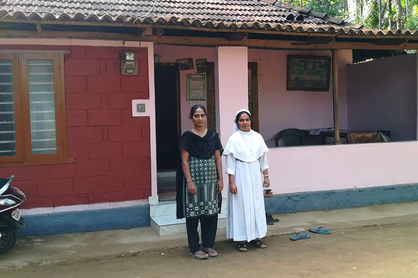 Sister Regin Mathew, right, helped Vincy Joy, a 42-year-old woman, overcome trauma after floodwaters submerged her house on the outskirts of Mananthavady, India, a town in Kerala state.