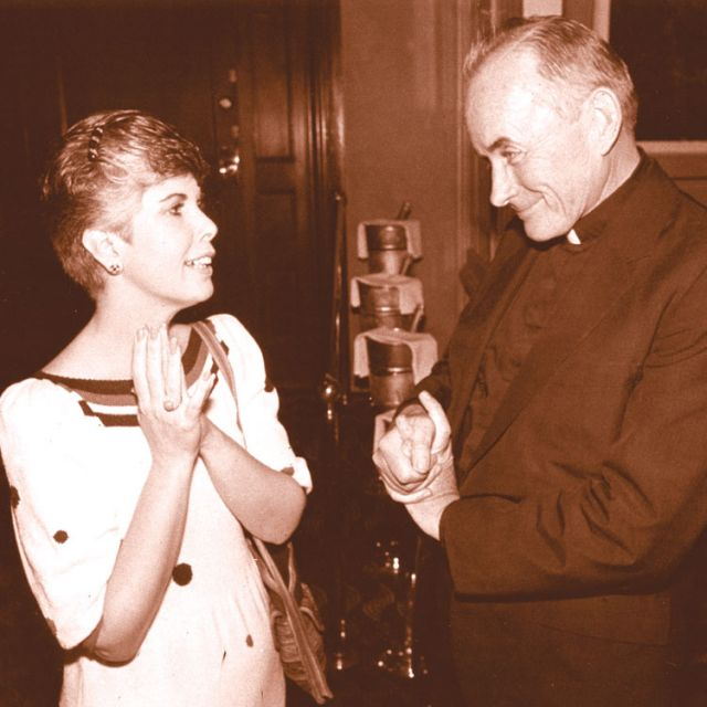 Fr. Andrew Greeley is pictured in a 1985 photo during a reception in his honour in Chicago.